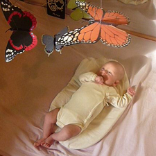 Baby watching the Butterfly Mobile