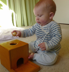 Box with wooden ball